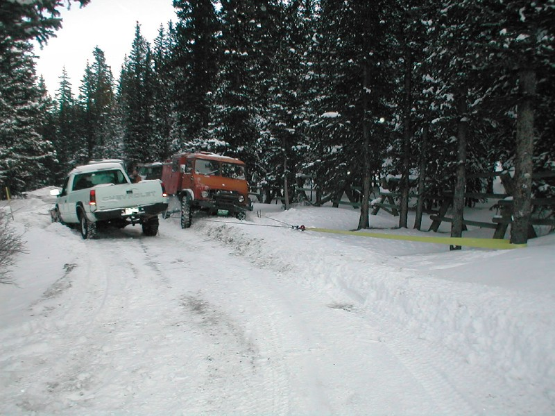 Towing the plow truck.